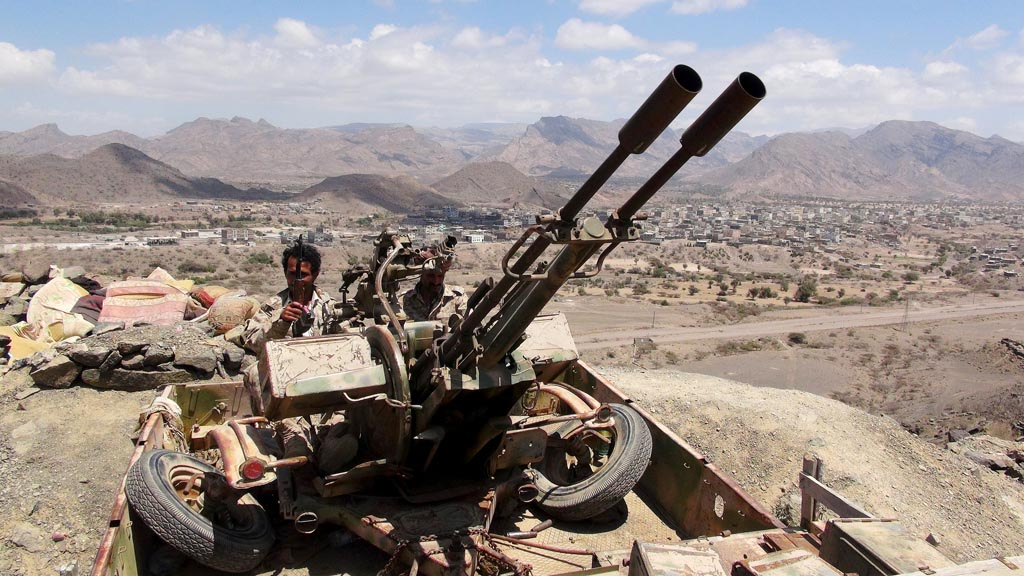 Southern People's Resistance militants loyal to Yemen's President Abd-Rabbu Mansour Hadi man an anti-aircraft machine gun the militia seized from the army in al-Habilin of Yemen's southern province of Lahej